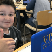 Visions student, Xavier P, giving a thumbs up