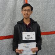 Male student smiles at the camera after winning the spelling bee